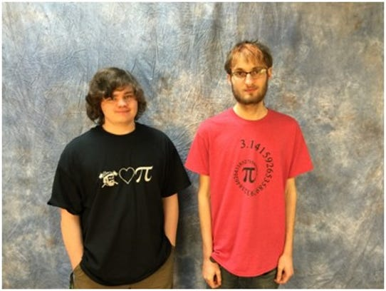 Luke Pagel and Carl Martens show off their Pi Day T-shirt