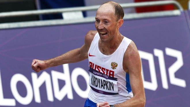 In this Aug. 11, 2012 file photo Sergey Kirdyapkin, of Russia, wins the gold medal in the men's 50-kilometer race walk at the 2012 Summer Olympics.