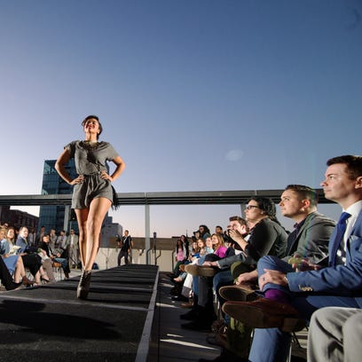 A photo by Justin Torner shows a rooftop fashion show