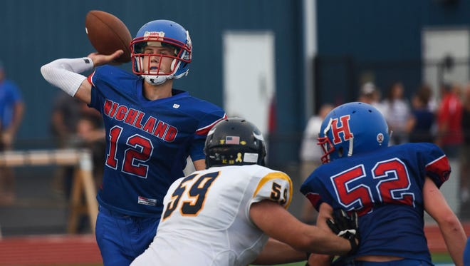 Highland senior quarterback Max Schreiber attempts a pass against River Valley earlier this season. Since that loss to the Vikings, the Scots have won five in a row.
