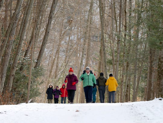 Walkers enjoy the warm weather and snowy trails of
