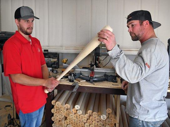 Leland Wetzel, left, and Ross Harrison inspect a freshly-turned