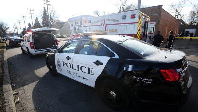 Kenosha police investigate a shooting scene on Saturday. A 26-year-old man died after being shot by a Kenosha police officer when officers tried to arrest the man for a felony warrant.