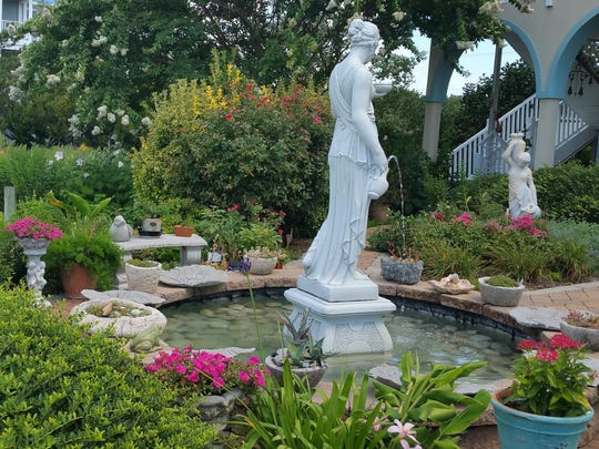 A formal fountain watches over the garden in the backyard of Lisa Arni's home.