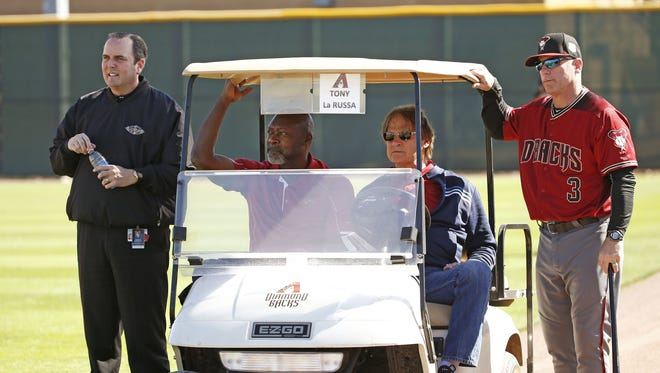 Arizona Diamondbacks President & CEO Derrick Hall, GM Dave Stewart, Chief Baseball Officer Tony La Russa and manager Chip Hale watch pitcher Archie Bradley throw during spring training practice in Scottsdale, Ariz., on Friday, February 26, 2016.