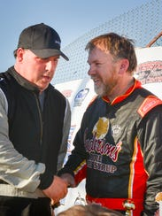 Runner-up Gary LaMonte (left) congratulates Dennis Prunty on his victory in the Slinger Speedway opener.