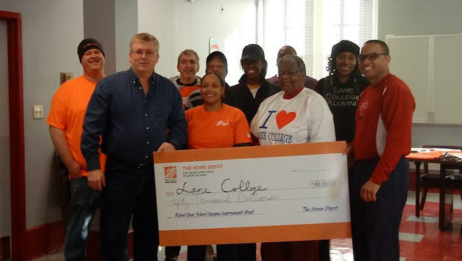 Home Depot representatives presented a $50,000 check to Lane College on Wednesday.