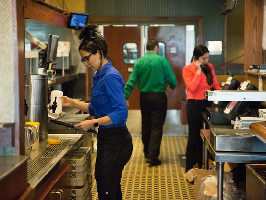 Rebecca O'Brien, a server at Ruby Tuesday, gets iced