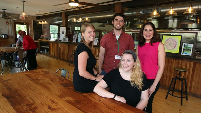 From left: Anna Hermann, Ted Marrinan, Nora Culhane and Filomena Fanelli, members of the Hudson River Housing running team, are pictured in the North River Roasters Coffee House in the Poughkeepsie Underwear Factory, June 1, 2017. They will be partaking in the Walkway Marathon to help raise money for Hudson River Housing.
