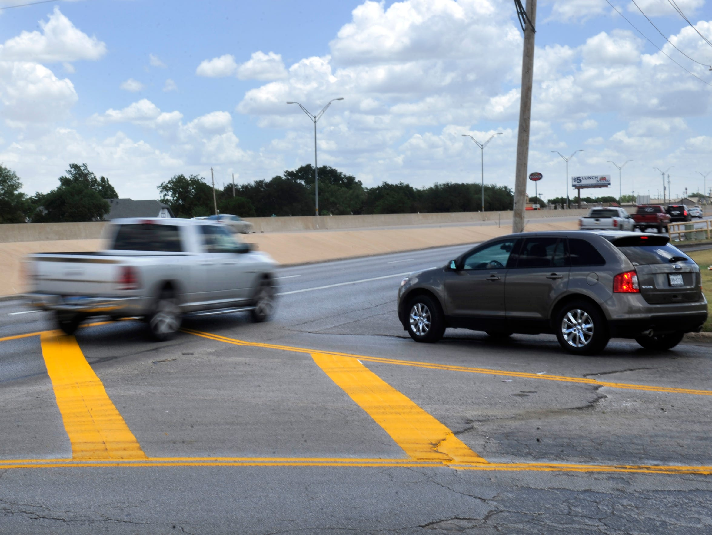A pickup drives through the new right-turn-only lane on South Clack Street at Curry Lane on July 19, instead of turning right as is now required for the far right lane.