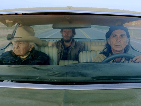 Nerburn (Christopher Sweeney, back seat) gets a tour