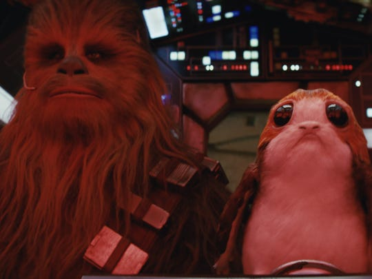 Chewbacca (Joonas Suotamo) has a special relationship with a porg in 'The Last Jedi.'