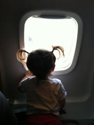 Harper Hughey checks out the view on a flight to Sweden