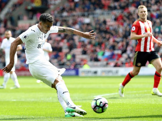 Swansea City's Kyle Naughton scores his side's second goal of the game, during the English Premier League soccer match between Sunderland and Swansea City, at the Stadium of Light, in Sunderland, England, Saturday May 13, 2017. (Owen Humphreys/PA via AP)