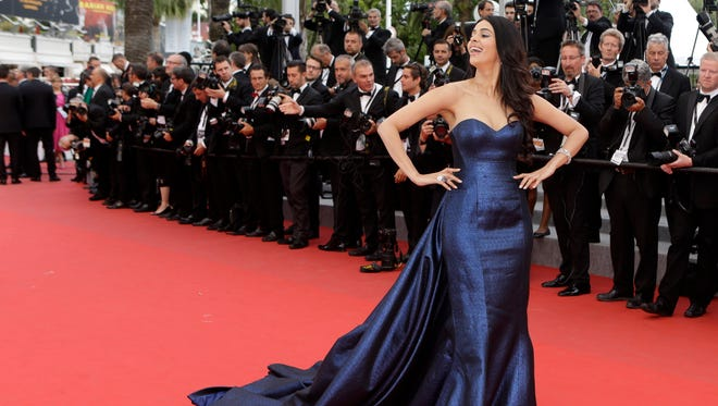 In this May 23, 2015 file photo, actress Mallika Sherawat poses for photographers upon arrival for the screening of the film Macbeth at the 68th international film festival, Cannes, southern France. The Paris prosecutor's office says Bollywood actress Mallika Sherawat and partner Cyrille Auxenfans were the targets of a botched robbery attempt involving tear gas in a posh area of the French capital.