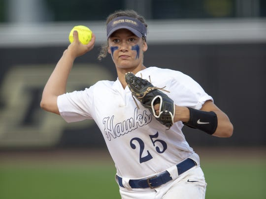 Decatur Central High School sophomore Kenzee Smith (25) fires a throw to first base to close out the play during the 34th Annual IHSAA Softball State Finals class 4A game, Saturday, June 9, 2018, at Bittinger Stadium on the campus of Purdue University, West Lafayette. Decatur Central High School defeated Lake Central High School 5-2.