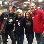 Bill MacDonald, Dean and Director of Ohio State University-Newark (far right), volunteered at St.  Mary's Food Bank in Arizona before the OSU football game against Notre Dame.
