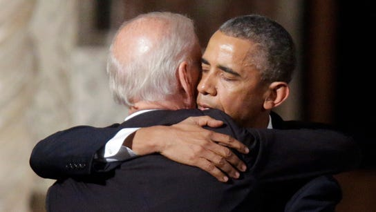 Vice President Joe Biden shares a hug with President