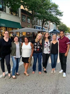 The Express Employment team poses for a photo in downtown Holland in August 2019. This year, the team took home multiple awards from ClearlyRated for exceptional service.
