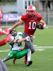 SJCC's Zach Militello tries to break a tackle against