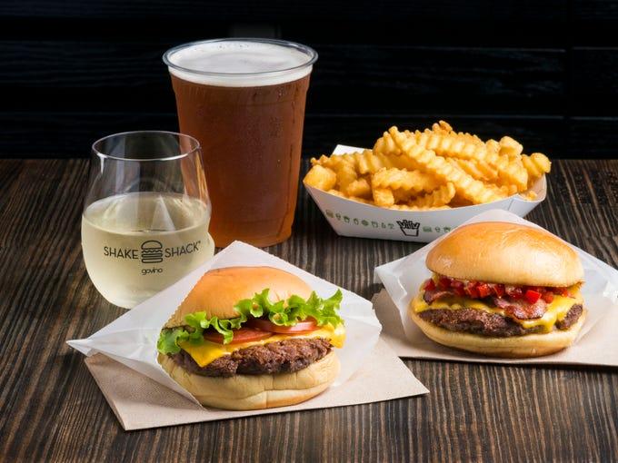 ShackBurger (L), SmokeShack, Cheeseburger topped with