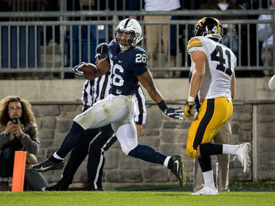 Penn State running back Saquon Barkley glides into the end zone for a touchdown against Iowa.