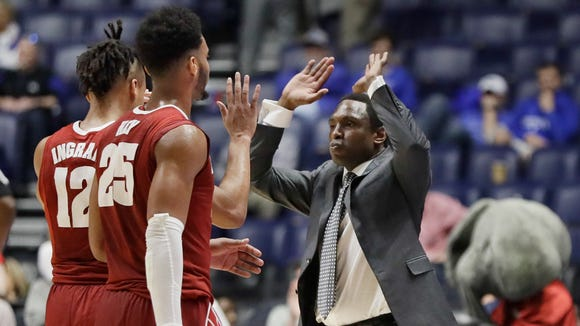 Alabama head coach Avery Johnson celebrates with Dazon Ingram (12) and Braxton Key (25) in the final seconds of the second half of an NCAA college basketball game against South Carolina at the Southeastern Conference tournament Friday, March 10, 2017, in Nashville, Tenn. Alabama won 64-53. (AP Photo/Mark Humphrey)