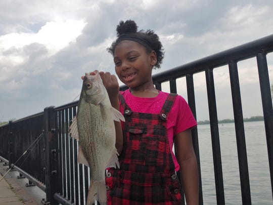 Yazmin Steele of Taylor learned to fish from her mom