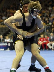 Iowa's Alex Meyer wrestles Missouri's Willie Miklus