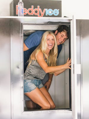 Matthew Stafford and Kelly Hall pose for an engagement photo.