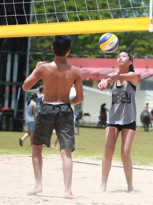 Evita Laguana bumps the ball during a double games match at the Guam Micronesian Island Fair beach volleyball century tournament on June 14.