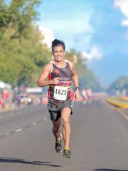 Derek Mandell is the first finisher at Guam Running Club's Liberation Day Mile Run on July 21.
