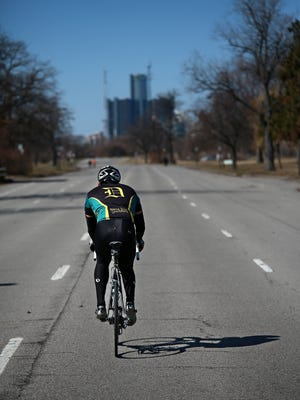 Wayne State University President M. Roy Wilson goes cycling at Belle Isle park in Detroit to promote the upcoming charity bike ride, the Baroudeur on Saturday, April 4, 2015.