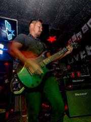 Flinched's guitarist Jonah Posadas performing with the band at Livehouse on Aug. 14
