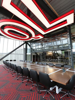 2015 photo shows the large conference room surrounded by glass windows at the new Quicken Loans Technology Center in Corktown, Detroit.