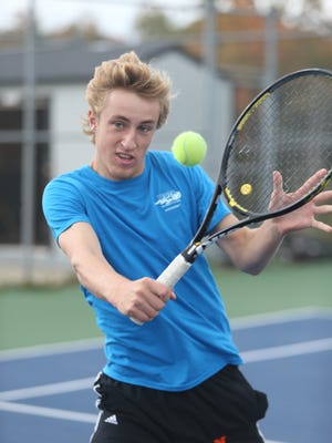 Connor Johnston prepares for the boys tennis state finals Monday, Oct. 12 at Northville high school.