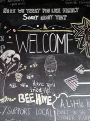 The Bar'ber Shop's welcome board is seen on Thursday, Oct. 29, 2015.