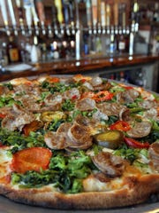 The Giuseppe Pizza at Tommy's Tavern + Tap in Sea Bright is topped with sweet Italian sausage, broccoli rabe, hot cherry peppers, mozzarella, San Marzano tomatoes, basil and extra-virgin olive oil.