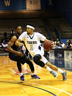 JSU guard Chace Franklin (1) sparked a Tigers rally with six consecutive points to end the first half.