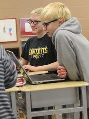 City High sophomores Rob Strang, back, and Isaac Bills