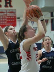 Julia Malson of Rossville puts up a shot after getting past Central Catholic's Cameron Onken.