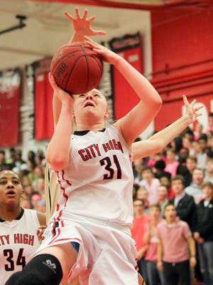 City High's Courtney Joens takes a shot during the Little Hawks' game against West High at City High on Friday, Feb. 12, 2016.