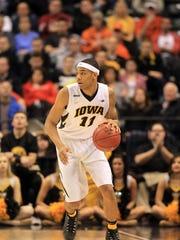 Iowa's Christian Williams takes the ball down court