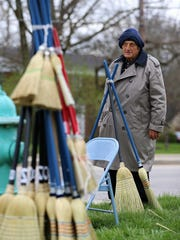 Jim Richter sells brooms last week at the corner of 71st Street and College Avenue. Richter, who learned to craft and sell brooms during his schooling at the Indiana School for the Blind, was recently told he can no longer sell outside post offices, where he frequently set up shop at locations on the Northside.