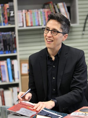 Alison Bechdel signs copies of her books at Daydreams Comics on Tuesday, April 5, 2016.