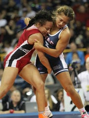 Kelsey Campbell, left, wrestles Alli Ragan in the 128-pound