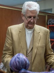 Jim Rocho shows hand-spun wool at the Battle Creek Regional History Museum.