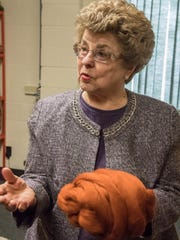 Roberta Rocho shows hand-spun wool at the Battle Creek Regional History Museum.