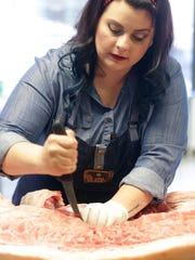 "Larissa Popa, a Butcher, a Charcutier and Chef  calls herself ""The Meatstress"" holds a whole hog seam butchery workshop at Eastern Market in Detroit Monday, May 16, 2016.