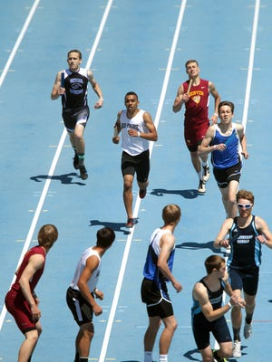 Mid-Prairie's Peyton Miller runs down to hand the baton to Andrew Schwartz during the 4x800 meter relay at the Iowa High School Track and Field championships at Drake Stadium in Des Moines on Thursday, May 19, 2016.